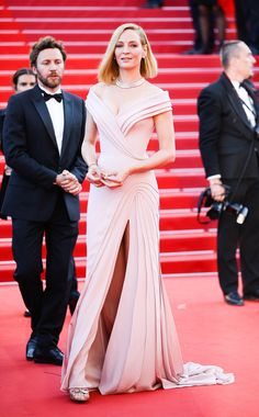Uma Thurman in Atelier Versace at the premiere of Ismael's Ghosts opening the Cannes Film Festival in Cannes, France, May 2017.