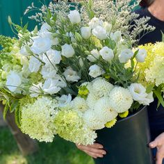 """This was a custom harvest in whites and creans. Our buckets of blooms include approximately 60 stems. We included a mix of foliages/greenery, accent flowers and """"feature"""" flowers, harvested from what is most beautiful and abundant in our flower field. These flowers come in buckets of water and typically fill 8-10 mason jars depending on how you design your arrangements. Water Bucket, Flower Farm, Buckets, Stems, Dahlia, Greenery, Your Design, Harvest, Mason Jars"""