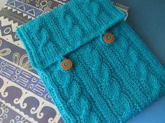 Ravelry: Cabled Tunisian iPad Cover pattern by Nuha.   This might be good for a purse or even a pillow as well.