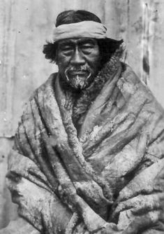 This shows a Patagonian man wearing a Quillango, which is basically just a cloak made of animal skin with fur on the inside for warmth due to the very cold weather.