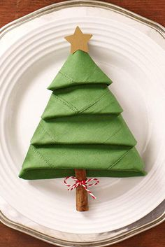 A Fun and Easy Holiday Craft: Christmas Tree Napkins. Get ready to impress your guests when you learn how to transform a green dinner napkin into a Christmas tree for your plate.