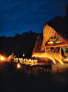 Room and board at Tanzania's Greystone Mahale includes fireside dinners at dusk.