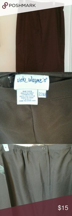 Women's brown skirt New long skirt that zips and buttons in the back. Has 2 small pleats in front and a slit in back. Never worn. Length is 38 in. from waist to hem. NWOT Vicky Wayne's Skirts Midi