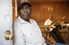 Photos: The Last of the Old School Mississippi Bluesmen Harp player Cadillac John Nolan at the home of Monroe Jones (in background) in Cleveland, MS.