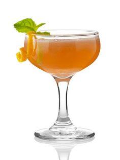 Mini Grapefruit Crush  1½ oz. grapefruit juice  ½ oz. Truvia simple syrup  2½ oz. brut champagne  Garnish: grapefruit twist and basil leaf