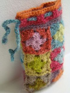 Crochet a mini granny squares pouch for your phone or glasses - very cute with a drawstring top