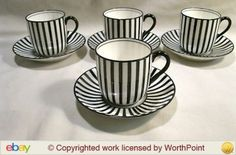 Doulton deco: unnamed demitasse / coffee cup duos by Robert Allen, E9670, RA8260, c1915 (pattern).  Starkly contrasted black stripes on white ground, with black band to inner cup rim and black highlights and trim.