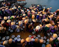 Locals peruse the offerings at a Hoi An, Vietnam fish market.