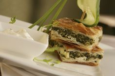 A delicious phyllo pie made with spinach and feta cheese, Spanakopita is a classic Greek favorite that will work as an appetizer, side dish, or meal.