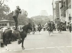 A hugely iconic and popular photo in its day of Warren Patriquin taking parade photos in Boston, while standing on the rock steady Morgan stallion Lippitt Victory to get a better vantage point. Lippitt Victory, a foal of 1942.