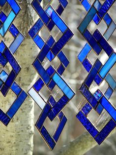 THIS LISTING IS FOR ONE BLUE CHAIN SUNCATCHER This blue chain is 18 inches in length and just under 5 inches across from point to point This piece is made up of six 4 squares. Each square is made up of various shades of blue glass. No two chains will be exactly the same. Each