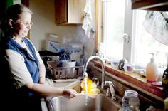 Sherry Vargson, of Granville Summit, PA, lighting her fracking-contaminated tap water.  • EXTEND YOUR LIFE > http://www.foreverhealthywater.com/fracking-chemicals-why-not.php