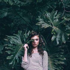 Girl in striped top in greenery big leafs dull image  http://keepsakethelabel.tumblr.com