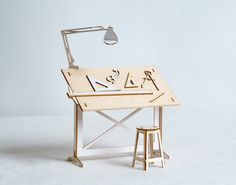 Miniature Drafting Table and Drawing tools Model Kit, Architect Designed from ThomasHouhaDesigns on Etsy. Saved to Thomas Houha Designs. Architect Table, Architect Design, Drawing Desk, Drawing Tools, Miniature Furniture, Dollhouse Furniture, Vitrine Miniature, Model Maker, Laser Cut Wood