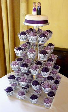 I just love the color purple and all it's variations. This tower really captures the beauty of mixing coordinating colors. The simple lace cut-out cupcake wrappers add a soft and uniform touch. Perfect! www.getcupcakepants.com