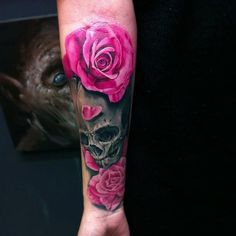 Vivid colors dark skull with pink roses forearm tattoo ...