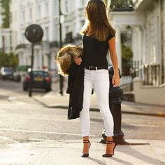 sometimes all you need with white jeans is a black top and classy accessories