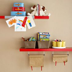 In a kids room small organizers make for quick and easy cleanup on sturdy shelves. Miniature buckets on a lazy Susan and wicker baskets give kids places to store art supplies and books. Hang paper towel bars underneath a shelf to store crafts paper. Weigh the edges down with clothespins to keep from curling. Attach a magnetic strip to the front edge of a shelf to display artwork.