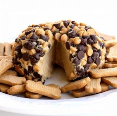 """This Peanut Butter """"Cheese"""" Ball is a creamy peanut butter mixture rolled in chocolate chips and peanut butter chips. the-girl-who-ate-everything.com"""