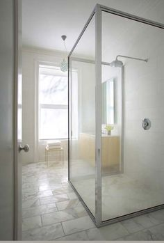 Custom shower enclosure and sink cabinet by Steven Harris Architects
