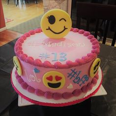 An Emoji cake for a teen girl. It's covered in buttercream with modeling chocolate Emojis madesweetbakery.wix.com/sweet