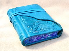 THIS MAKES ME SO HAPPY!!!  Must have this soon!  Light Blue Leather Journal Sculpted Ornate Relief by Leatherdust