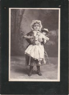 MY DOLLY & ME~Antique cabinet card photo of a little girl with her doll, circa 1890.