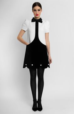 Combined A-shape black and white velvet dress. Band collar. Short balloon sleeves. Inset side pockets. Hidden back zip closure. Figured bottom.