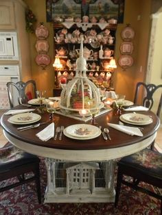 see the little bird cage on the table ?   Look UNDER the table !    WOW !