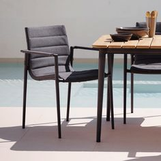Core Dining Chair by Cane-Line Versatile and practical, the Core Dining Chair, Set of 2 combines the comfort of indoor furniture with the robustness of outdoor materials.