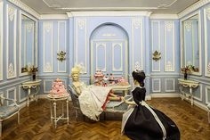 Good Sam Showcase of Miniatures: Room and furniture designed by Cristina Noriega. Marie Antoinette by IGMA Artisan Maria Jose Santos, Carabosse Dolls, Spain. She wears a replica of a 1780's costume at the Victoria & Albert Museum of London. Cakes by Teresa Martinez.ealer Cristina Noriega, Spain - Furniture