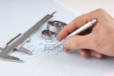 pen in de hand en technische tekening op grafiek papier Stockfoto - 7938081 Paper