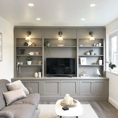 Statement lighting or unexpected design touches can help to create a room that& full of character. Built In Shelves Living Room, Built In Wall Units, Living Room Wall Units, Living Room Tv Unit Designs, Home Living Room, Interior Design Living Room, Living Room Cabinets, Tv Wall With Shelves, Tv Wall Unit Designs