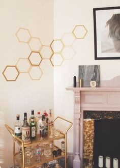20 DIY Projects You Can Make for Under $10 - Hexagon wall decals + potato stamp chevron art