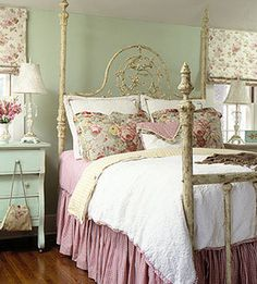 Cozy Style Bedroom with pink and printed fabrics, iron bed and sea foam accent furniture matching the walls. [link expired]