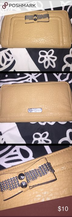 Jessica Simpson Wallet Cute tan Jessica Simpson wallet. It's in fair condition. Some of the metal balls have fallen off of the bow and my dog decided he wanted to try and have it for a snack one day so there is a little piece missing near the bow. Pictures of these imperfections have been included Jessica Simpson Bags Wallets