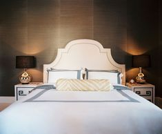 """""""A bedroom should be all about comfort, sexiness, and glamour,"""" says Zung. The designer commissioned a custom-made headboard and side tables for the room."""