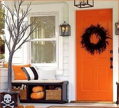 Cute Halloween porch with awesome orange door!  www.fancyhouseroad.com