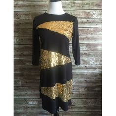 NEW Black & Gold Sequin Bling Party Dress Med Black jersey knit party dress with gold sequin embellishments. Great for the upcoming holiday season or New Year's eve! Size medium. Small and large available in separate listings.Dress: Polyester\rayon\spandex. Sequins on mesh material. New without tags. Dresses Long Sleeve