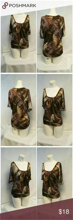 "CHARLOTTE RUSSE, Browns n Golds Design Top, size M CHARLOTTE RUSSE, Browns n Golds Design Top, size Medium See Measurements, gathering under center front deep scoop neck, open Batwing Sleeves no bottom seam on sleeves, side rusching seams, machine washable, polyester blend, approximate measurements: 30"" length shoulder to hem, 16"" bust laying flat, 9"" sleeves.  ADD TO A BUNDLE! 30% Automatically Discounted on all Bundles! Charlotte Russe Tops"
