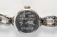 """The back of the watch Hitler gave to Eva Braun. The inscription reads: """"On February 6, 1939. With all my heart. A. Hitler."""" Many such trinkets are kept hidden away in the Pinakothek der Moderne in Munich."""