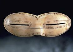 """Some of the world's oldest sunglasses were discovered on north Baffin Island"" -- ""...credit the Eskimo or Inuit...for the world's first sunglasses. Often referred to as snow goggles, they were created from bone, leather or wood with small slits...designed to protect the eyes from snowblindness caused by the bright spring sunlight. ...This example...was crafted from walrus ivory & dates back to between 1200AD & 1600AD. They are now in the collection of the Canadian Museum of Civilization..."""