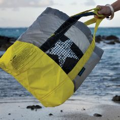 My friends on Maui make these from recycled kite board sails.  So Cool!  Sailbags Maui   Maui Hawaii   Recycled Bags