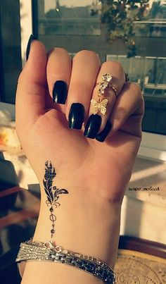 cute small feather tattoo