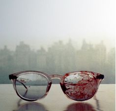 place a pair of bloody glasses on a bathroom sink.