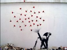 Banksy, Flowers launched out of a missile weapon. Banksy Graffiti, Bansky, Graffiti Artwork, Murals Street Art, Street Art Banksy, Urban Street Art, Urban Art, Urban Decor, Amazing Street Art