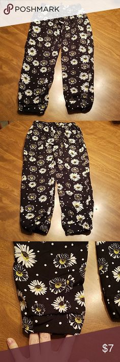 BNWOT Black pants with daisies Super cute and comfy pants with elastic waist and tieable string in the front. These remind me of the classic fashion cigarette pants women wear to work and out on the town. My daughter never worn them because they were too girly for her haha. Size 6/6X Bottoms Casual