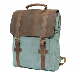 Material:real leather and canvas    Size:L31CM X W11CM X H42CM    Large capacity,easy to carry 15 laptop, A4 paper