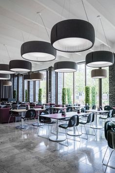 At the Charlottehaven Cafe in Copenhagen, lighting designers are tackling the problem of noise pollution. #RestaurantDesign #ArchiJuice #hospitalitydesign Cutting noise… with lighting