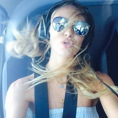Candice Swanepoel in a helicopter